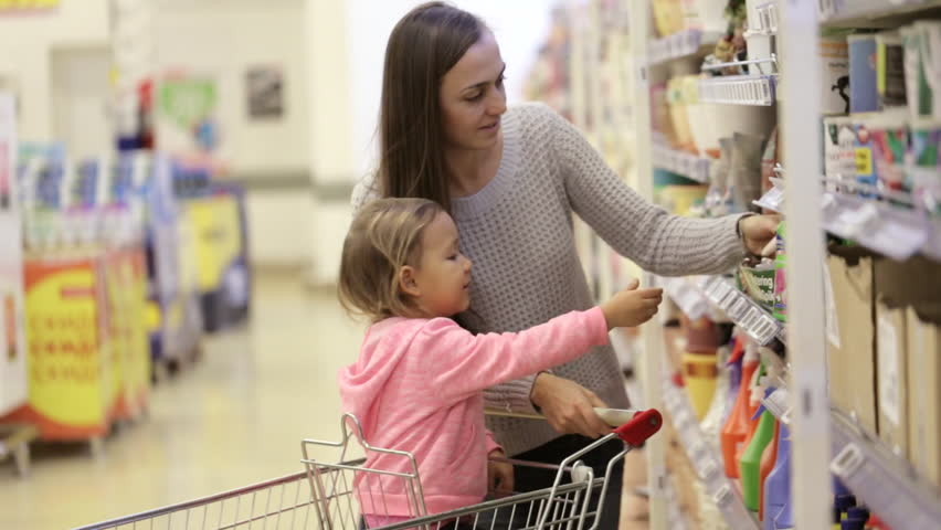Mother and daughter shopping in supermarket. Mom and girl choosing goods for garden. | Shutterstock HD Video #21411496
