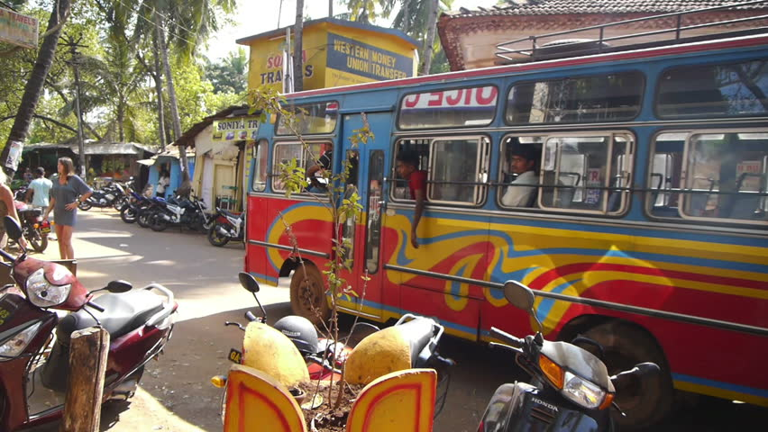 GOA - FEB 12: Busy rural street with many motorbikes and tourists on February 12, 2012 in Goa, India.