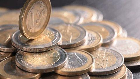 Euro coin on money pedestal - financial power concept, closeup dolly shot
