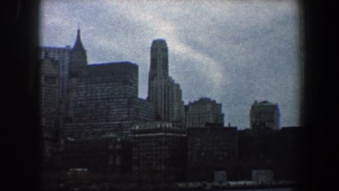 NEW YORK CITY 1960: a large city skyline with skyscrapers on the water's edge