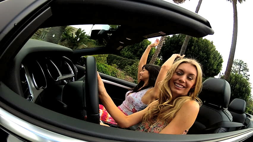 Two Females Fun Driving Open Top Convertible Wide Angle