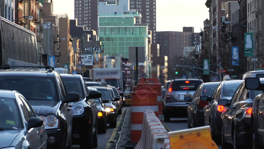 Traffic jam. Heavy congestion on the lower east side of Manhattan due to construction. Modern buildings in background. Wide Shot.