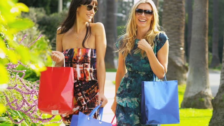 Young girlfriends laughing on a fun day of shopping