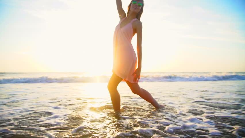Beach lifestyle sea recreation leisure travel slim Caucasian American female dance Summer holiday sunset flare | Shutterstock HD Video #21534223