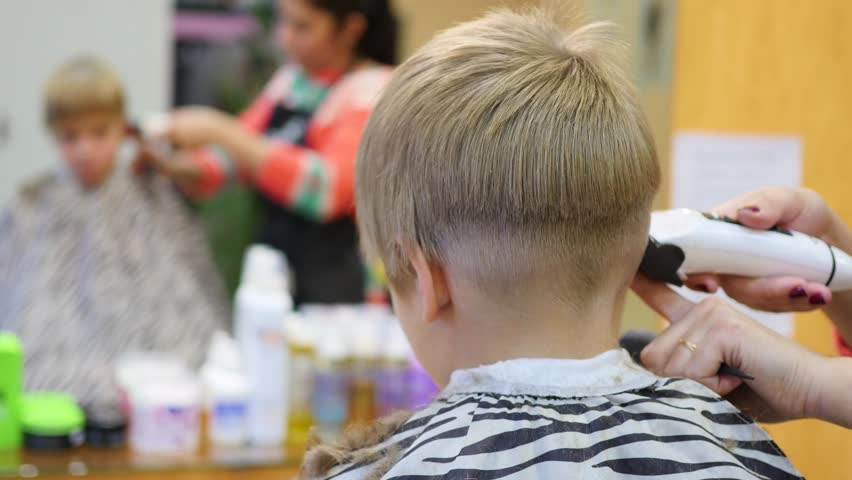 Stock video of child39s haircut at the barber shoplooking stock video of child39s haircut at the barber shoplooking 21549466 shutterstock solutioingenieria Gallery
