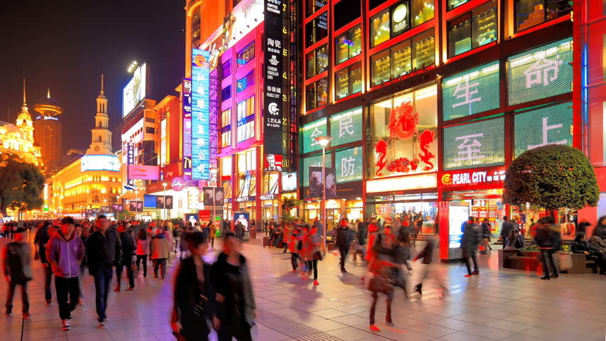 SHANGHAI - CIRCA MARCH 2012: Time lapse of extremely busy pedestrian mall on Nanjing Road circa March 2012 in Shanghai, China.