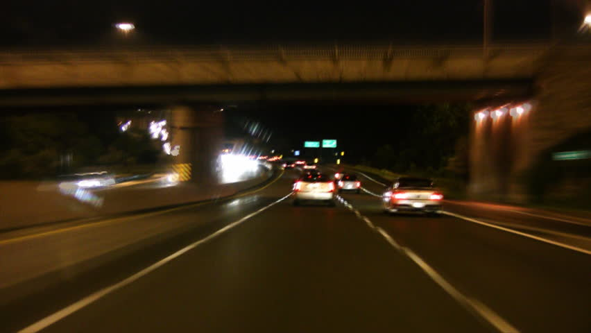 Timelapse shot. Driving at night on a wet, Toronto highway.