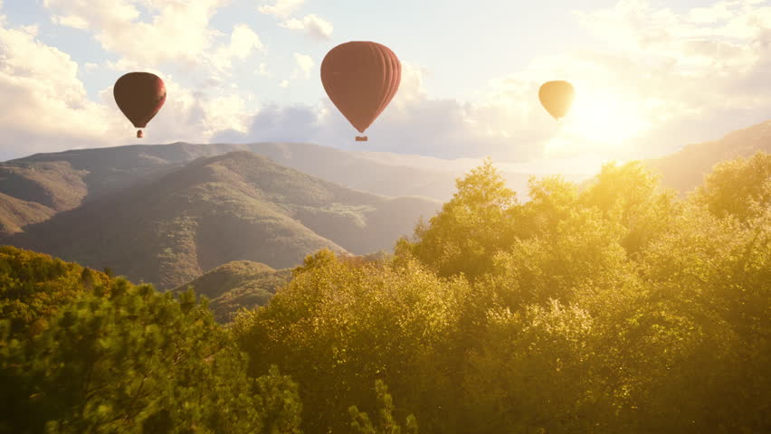 Hot Air Baloons Aerial Drone Flight Over Beautiful Autumn Forrest at Sunet Mountains Beautiful Landscape Background Sunny Vacation Travel Destination Concept | Shutterstock HD Video #21576136