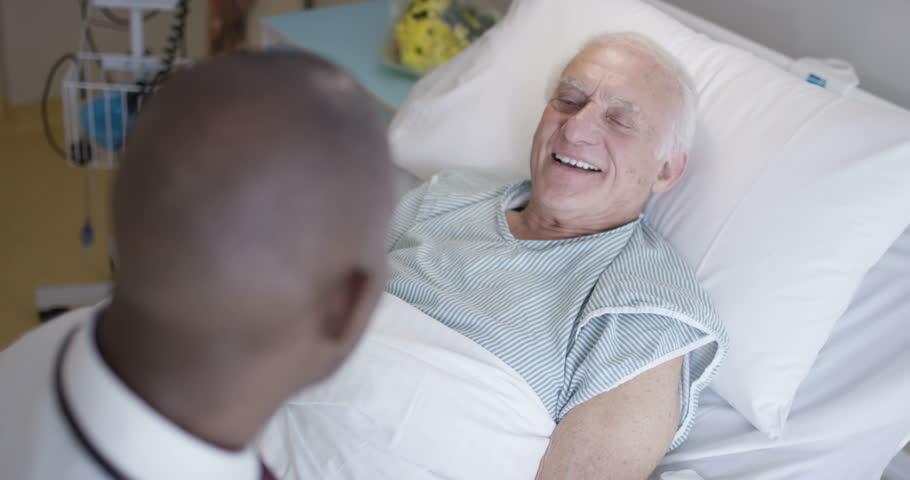 4K Friendly doctor talking to elderly patient at his bedside (UK-Oct 2016)   Shutterstock HD Video #21578296