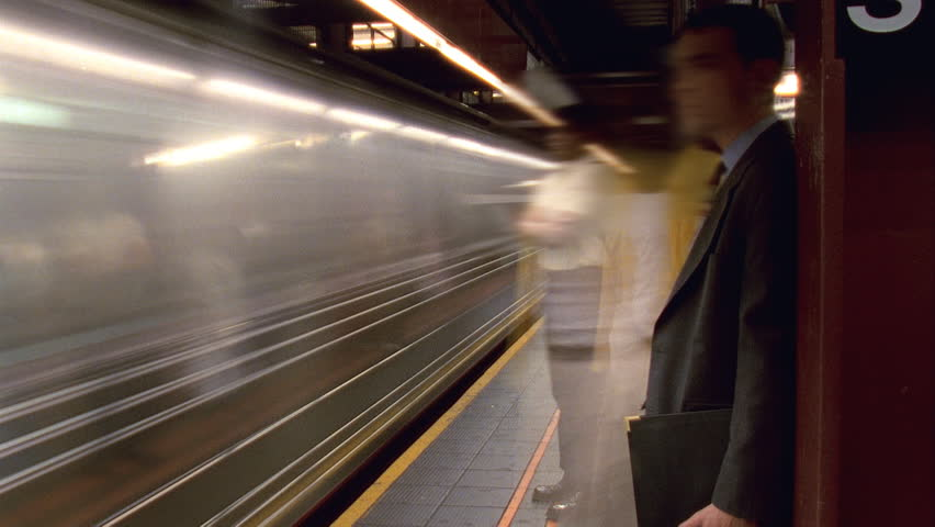 NEW YORK - CIRCA 2003: Timelapse of people waiting for trains in the 14th Street subway station in New York City circa 2003