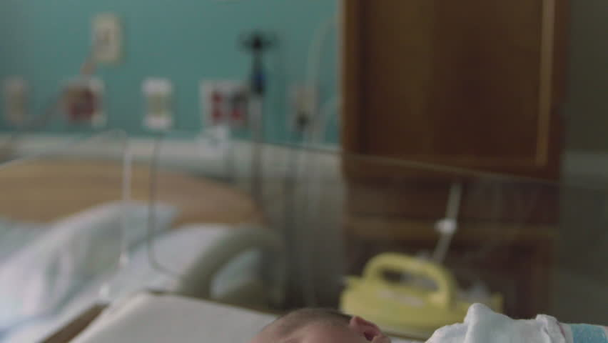 Cute 1 Day Old Newborn Baby in Hospital Delivery Room Bed Sticking Tongue Out | Shutterstock HD Video #21586546