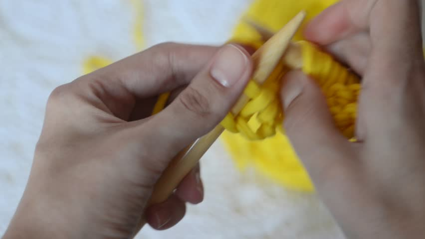 Close-up female's hands knitting thick fabric yarn. Hobby handiwork concept | Shutterstock HD Video #21616006