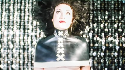 sexy woman dressed in fetish latex top. this video has been distorted with video effects