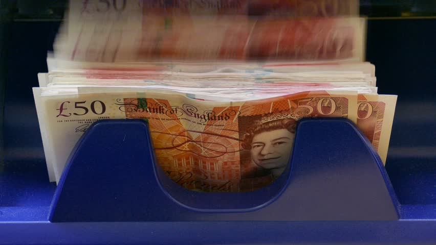 British Pound notes counted by a Currency counting machine  | Shutterstock HD Video #21651406