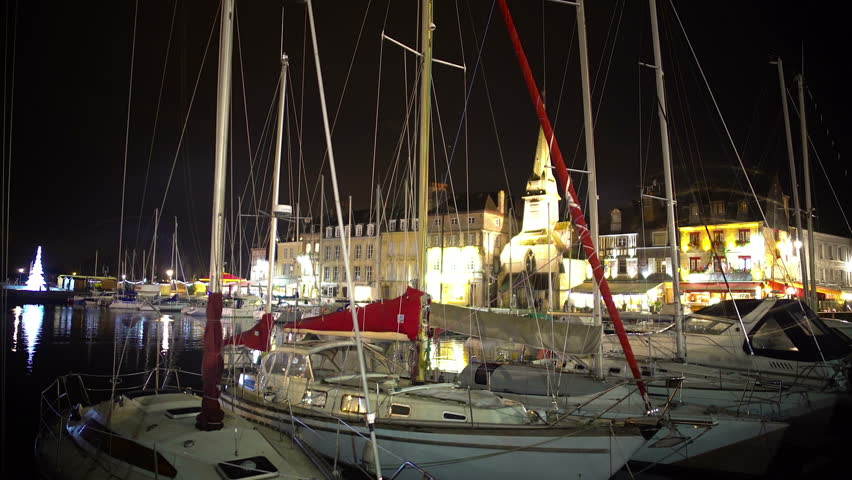 Christmas time in cozy town, view on yachts and boats moored in harbor at night | Shutterstock HD Video #21653176