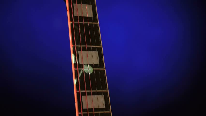 Acoustic Electric Guitar On A Dark Blue Background Sheet Music Luminous Notes