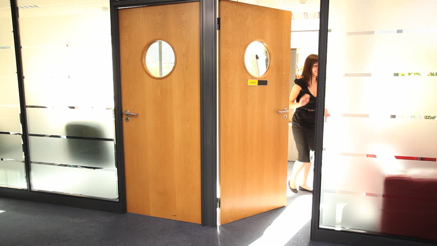 Female entering door and close for meeting with colleagues