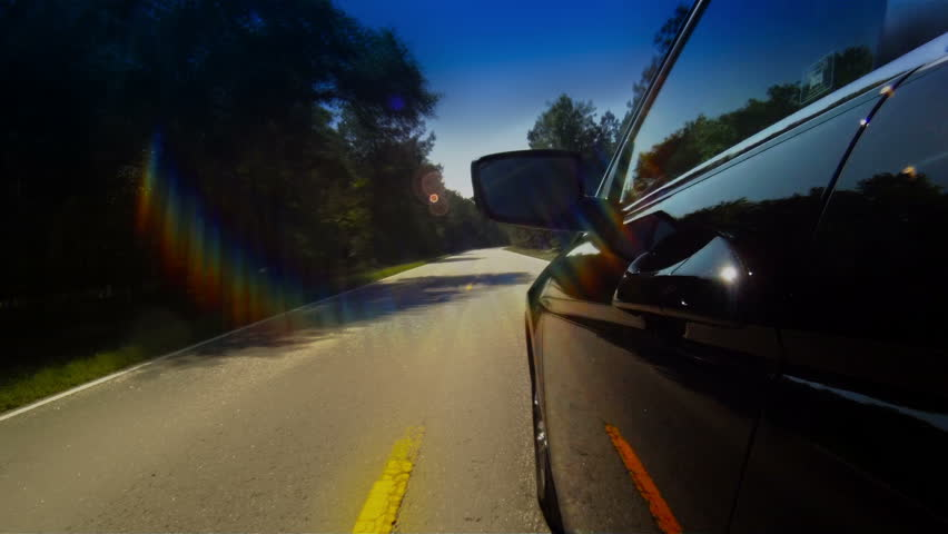 Timelapse of car driving down narrow road | Shutterstock HD Video #2169317