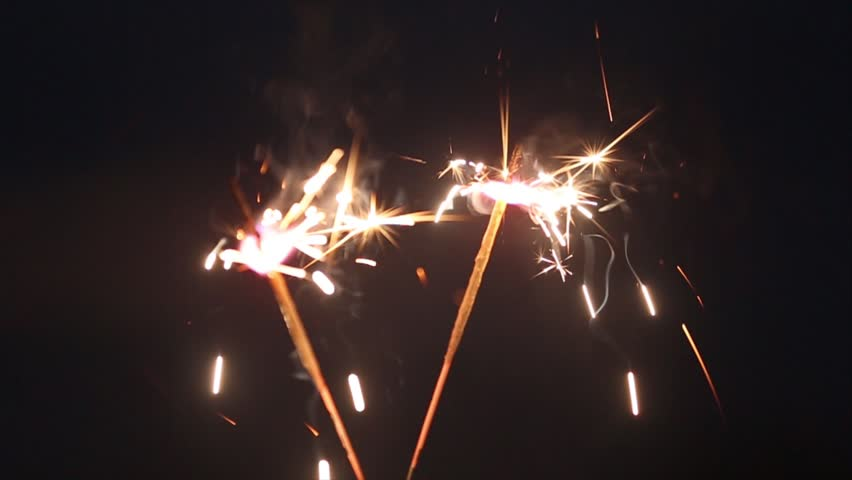 Burning Yellow Christmas Sparkler With Big Amount Of Particles