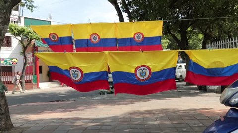 Rows of Colombian flags wave on line in breeze (HD)