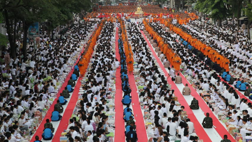 BANGKOK, MARCH 18, 2012: Monks are participating in a Mass Alms Giving of 12,600 monks for the Makha Bucha celebrations in Bangkok, Thailand  on March 18, 2012.