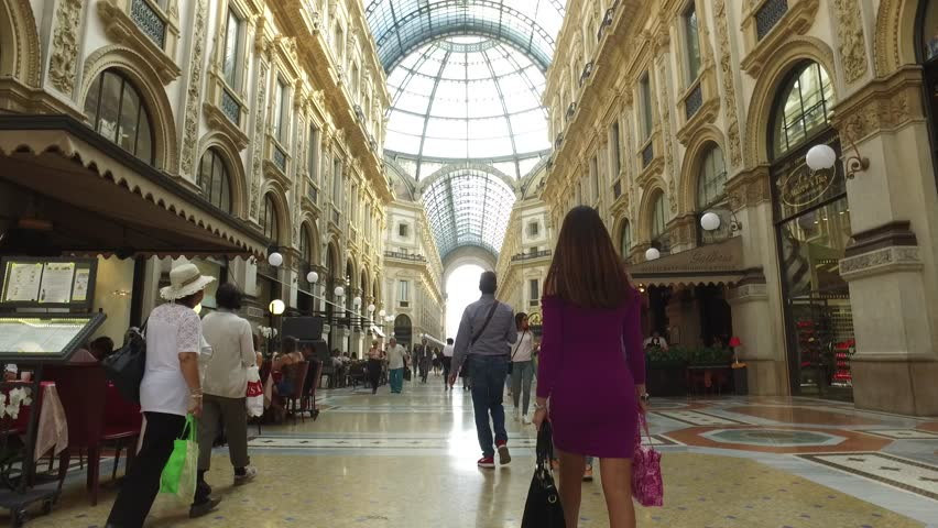 MILAN, ITALY - CIRCA SEPTEMBER, 2016: POV view of Vittorio Emanuele II Gallery with dome. It's one of the world's oldest shopping malls, designed and built by Giuseppe Mengoni between 1865 and 1877.