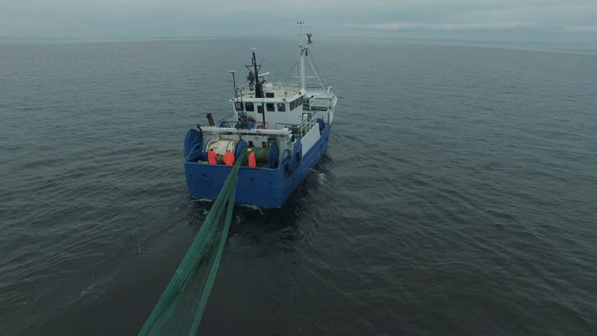 Aerial Shot of a Commercial Fishing Ship that Pulls Trawl Net. Shot on Phantom 4K UHD Camera.