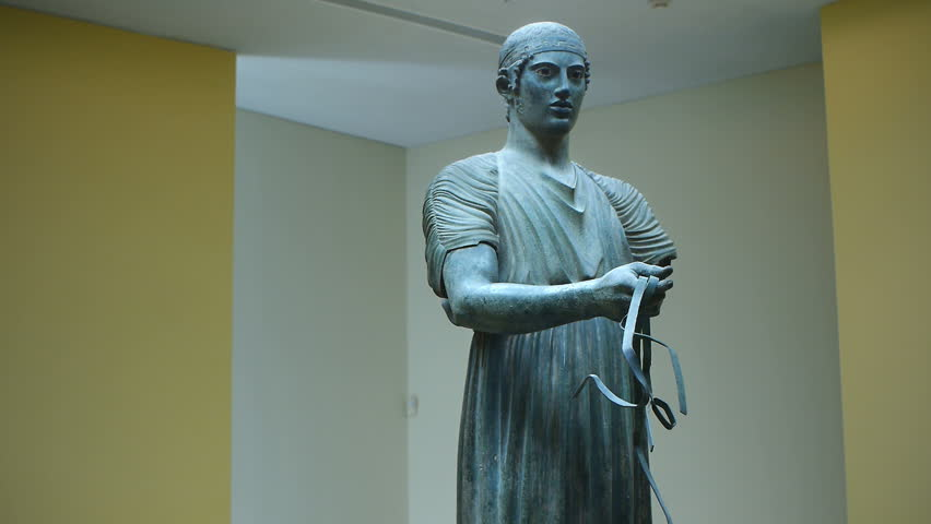DELPHI, GREECE - CIRCA AUGUST 2016: Charioteer of Delphi is one of the most well preserved bronze statues surviving from ancient Greece. Also known as Heniokhos is now located in the Delphi Museum
