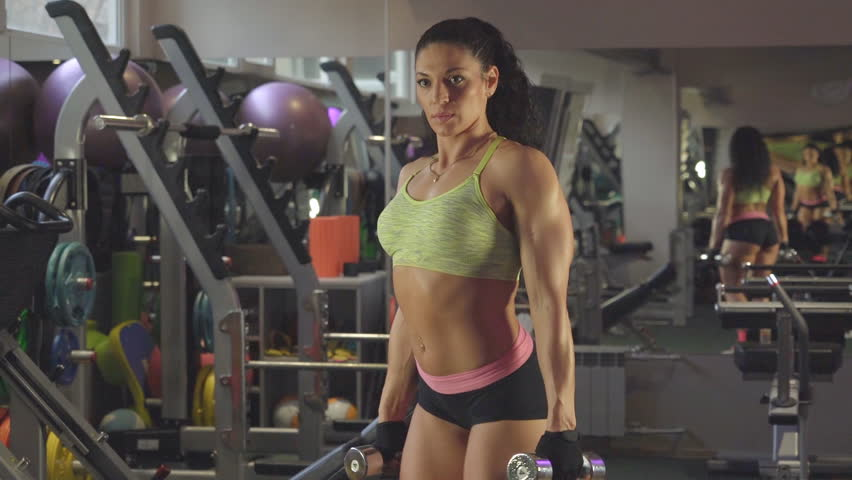 Girl in sportswear doing exercises with dumbbells | Shutterstock HD Video #21880606