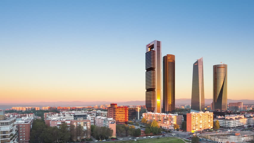madrid skyline financial district timelapse from night to day panning