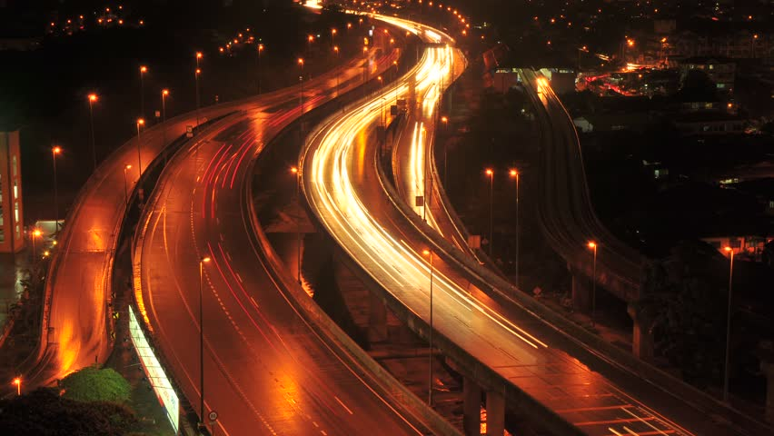 Time lapse (slow motion or stop motion) light trail traffic on a freeway
