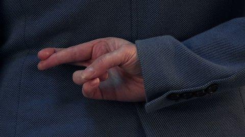 Dishonest businesswoman telling lies, lying female entrepreneur holding fingers crossed behind her back