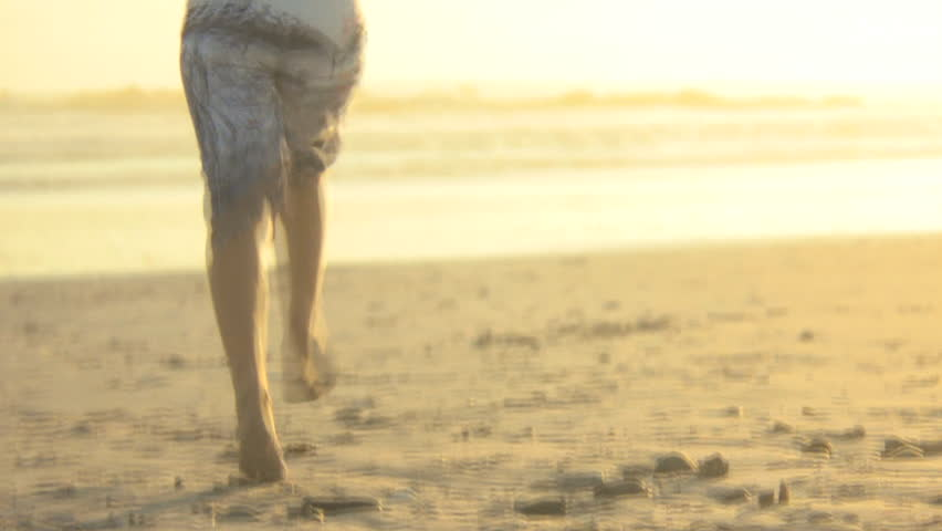 WIDE SHOT FOCUS SHIFT REAR VIEW OF A YOUNG WOMAN RUNNING TO THE SEA | Shutterstock HD Video #2193406