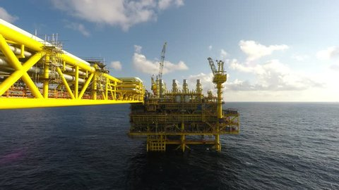 Time lapse of oil and gas platform in the middle of South China sea, blue sky and thick clouds