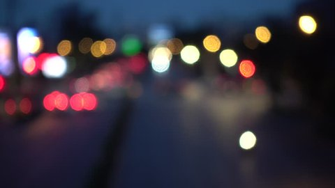 4K Bokeh of car lights. On the street at night Colorful Circles Video Background Loop Glassy circular shapes perform a colorful dance. motion background that is just perfectly suited for events