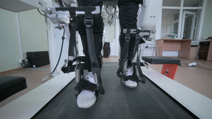Man with innovative robotic VR cybernetic system walking like a robot.
