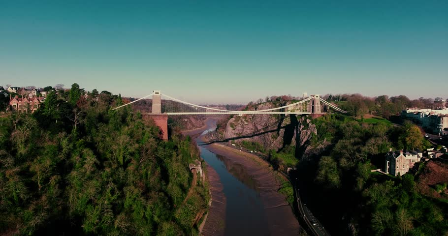 Aerial shot of Isambard Kingdom Brunel's iconic Bristol Clifton Suspension Bridge. Beautiful smooth drone shot of the Avon Gorge and the suspension bridge filmed on a sunny day in December.  #21984607