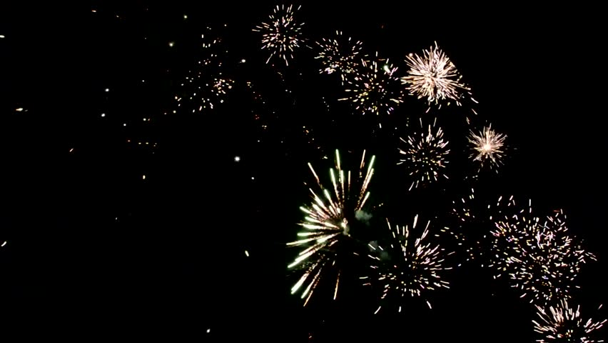 brightly colorful explosive fireworks light up the night sky at new years eve celebrations happy new year 2017 and holidays