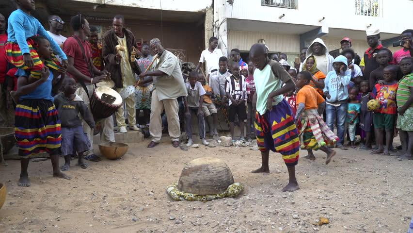 Traditional African dance in Dakar slum - 2016 April: Dakar, Senegal