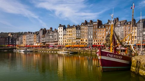 Honfleur Harbour Old Port, France, timelapse with beautiful houses and lots of tourists. Honfleur is located in the northern region of Calvados, Normandy, France