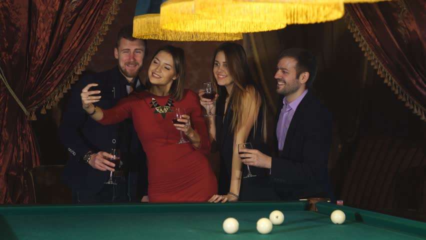 Two couples at the party take a selfie with glasses | Shutterstock HD Video #22040707