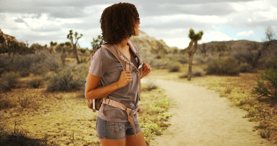 Cute African woman hiking Joshua Tree, National Park. Black woman on hike in Mojave Desert. | Shutterstock HD Video #22104226