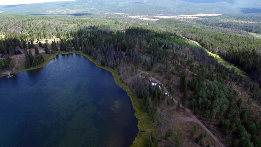Elevated, Slow Moving Drone View Of Lyman Lake And Forest