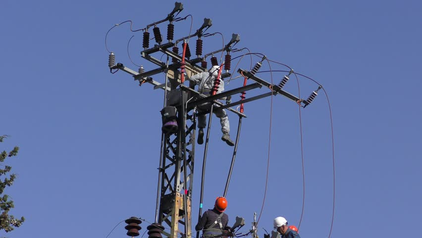 Electricians Of The Israeli Electric Co Fixing High Voltage Electrical  Lines, Replacing A Transformer After