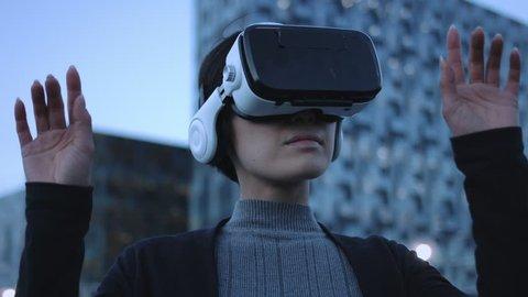 Asian female Using Virtual Reality outside