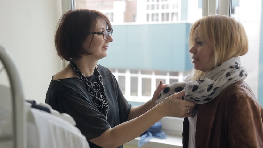 Stylist shows to purchaser how correct tie volume silk scarf. | Shutterstock HD Video #22182616