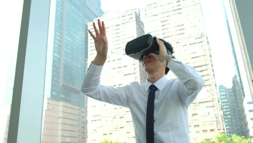 Businessman in virtual reality goggles holding business meeting in the office | Shutterstock HD Video #22186699