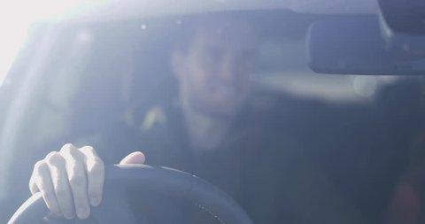 Driver adjusting rear view mirror\xCA