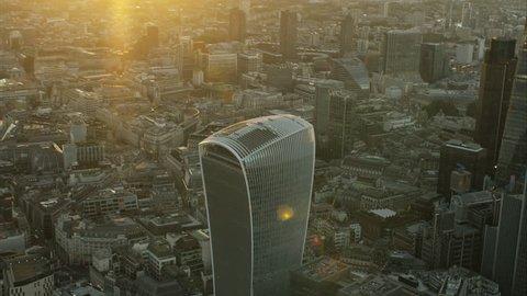 Aerial sunset view of landmark Walkie Talkie building in the international capital city of London UK RED DRAGON