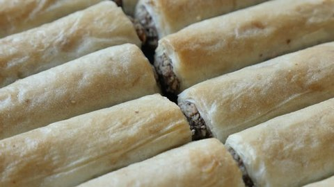 Traditional Turkish phyllo pie baklawa with walnuts 4K 2160p 30fps UHD tilting footage - Arabic dessert filo dough baklava sweet rolls filled with nuts slow tilt 3840X2160 UltraHD video